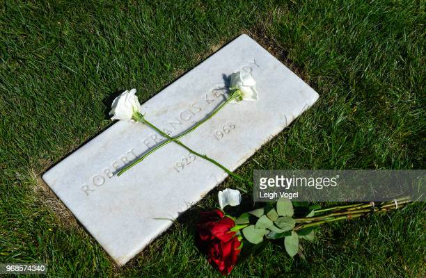 Flowers are placed on the marble tombstone marking the grave of Robert F Kennedy during A Remembrace and Celebration of the Life Enduring Legacy of...