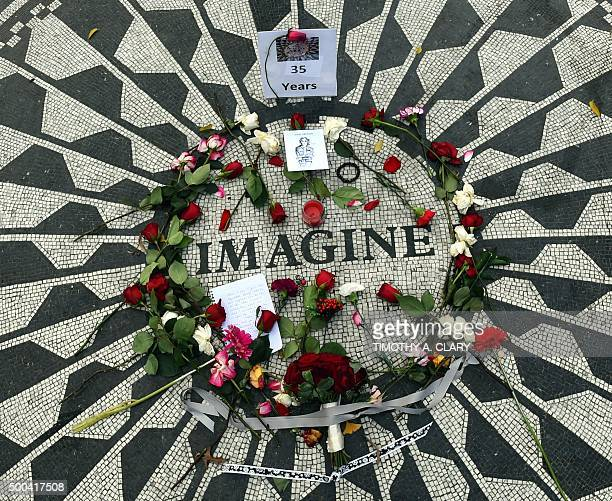 Flowers are placed on the mosaic named for the John Lennon's song Imagine December 8 2015 at Strawberry Fields the Central Park garden dedicated in...