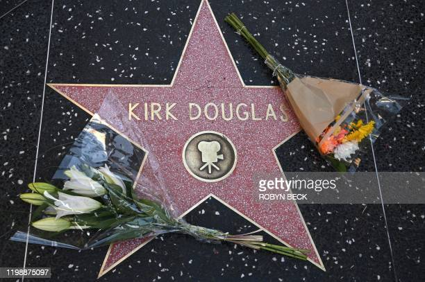 Flowers are placed on the star of late actor Kirk Douglas February 5 2020 on the Walk of Fame in Hollywood California American cinema giant Kirk...