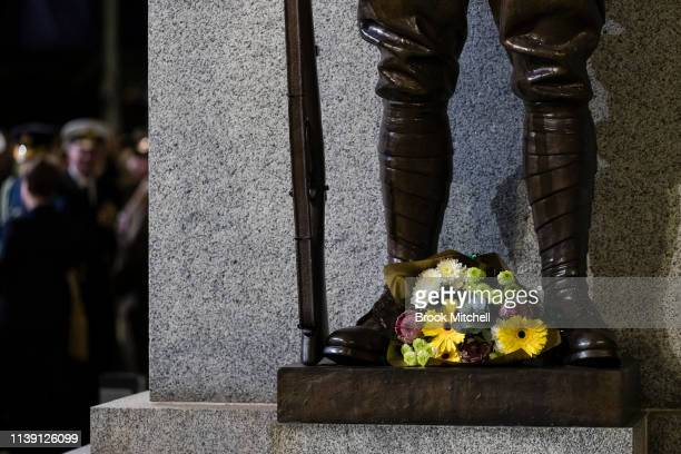Flowers are placed on the The Cenotaph in Martin Place on April 25 2019 in Sydney Australia Australians commemorating 104 years since the Australian...