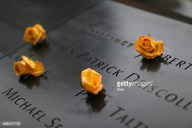 Flowers are placed over names of vicitims of September 11 2001 at the South Tower Memorial Pool before memorial observances are held at the site of...