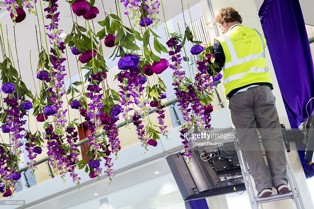 Flowers are put in place as the finishing touches are added ahead of Royal Ascot 2014 at Ascot Racecourse on June 16, 2014 in Ascot, England.