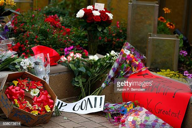 Flowers are seen at a memorial following the death of boxing legend Muhammad Ali outside the Muhammad Ali Center June 4 2016 in Louisville Kentucky...
