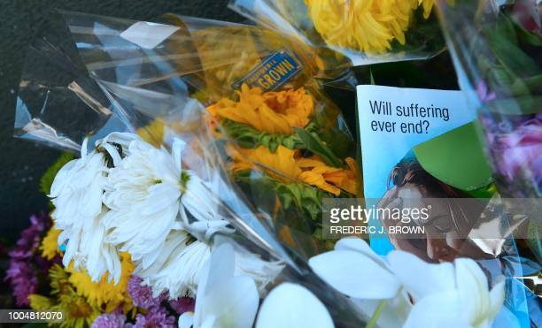 Flowers are seen at a memorial for Melyda Corado the assistant manager at the Silver Lake Trader Joe's who was killed in a July 21 shootout between...