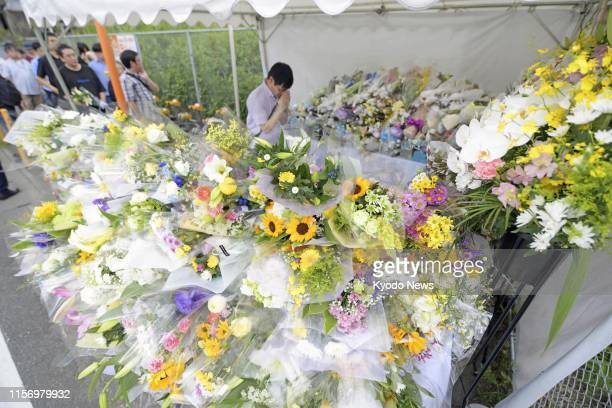 Flowers are seen at an alter set up near the site of a Kyoto Animation Co studio in Kyoto on July 21 three days after a man set the threestory...