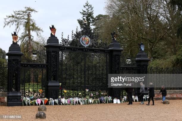 Flowers are seen at the gates to Sandringham House on the royal Sandringham Estate in Norfolk on April 09, 2021 in Sandringham, United Kingdom. The...