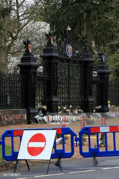 Flowers are seen at the gates to Sandringham House on the royal Sandringham Estate in Norfolk on April 10, 2021 in Sandringham, United Kingdom. The...