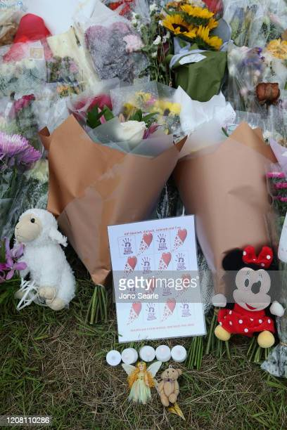 Flowers are seen during a vigil to remember murdered mother Hannah Clarke and her three children at Bill Hewitt Reserve in Camp Hill on February 23...
