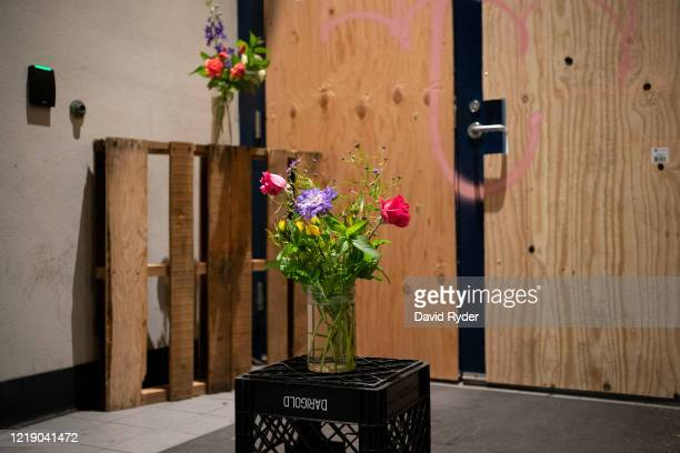 Flowers are seen in front of a door to the Seattle Police Departments East Precinct on June 9, 2020 in Seattle, Washington. Protests have continued...