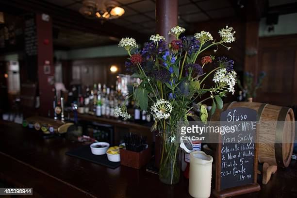 Flowers are seen in the bar area of the Royal Oak pub on Columbia Road on August 27 2015 in London England The Royal Oak pub was named as one of 21...