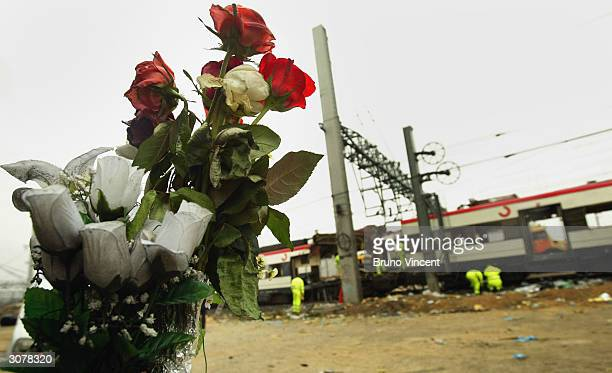 Flowers are seen left as a tribute to those who died in the terrorist bombings on three trains at Atocha train station on March 12, 2004 in Madrid,...