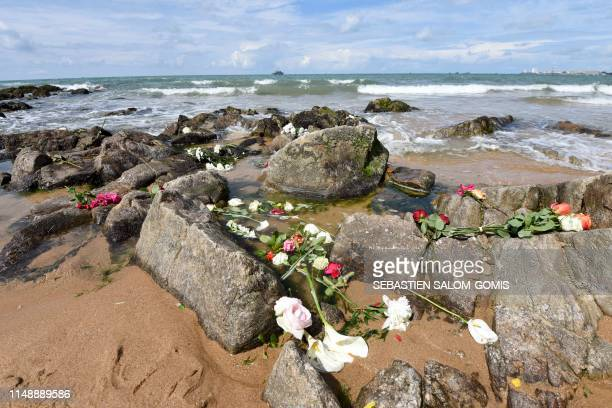 TOPSHOT Flowers are seen on a beach of Les Sablesd'Olonne on June 10 after thousands of people took part in a tribute to three rescuers killed on...