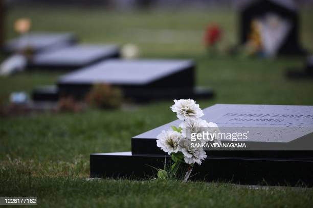 Flowers are seen on the graves of the Christchurch's terror attack victims at the Memorial Park Cemetery on the first day of the fourday of...