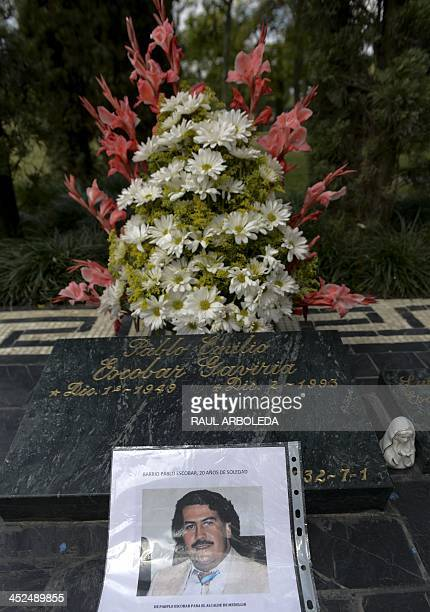 Flowers are seen over the tomb of Colombian drug lord Pablo Escobar on November 29 2013 at Montesacro cemetery in Medellin Antioquia department...