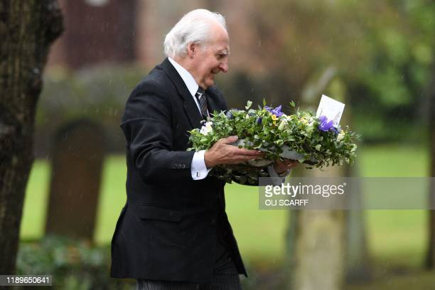 Flowers are taken to the church as family and friends of the victim of the terror attack in Fishmongers' Hall on London Bridge University of...