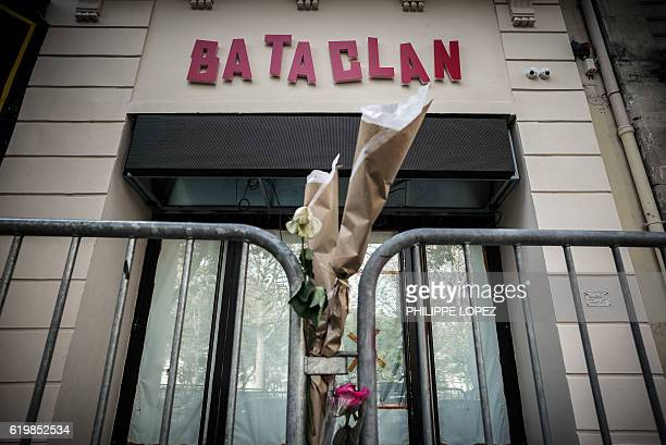 """Flowers are tied to a fence outside the """"Bataclan"""" concert hall during All Saints' day in Paris on November 1 one of the targets of the November 13,..."""