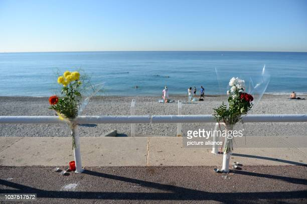 Flowers are tucked to a fence near the spot where someone was killed on Promenade des Anglais in Nice France July 17 when a truck drove into a crowd...