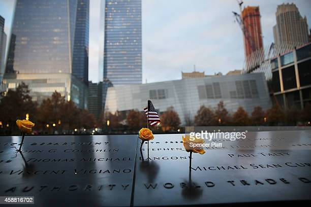 Flowers are viewed at the 9/11 Memorial where flowers are placed on the names of veterans killed on September 11, 2001 for Veterans Day in New York...