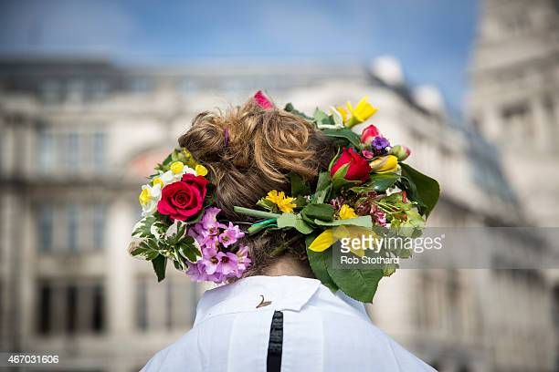 Flowers are worn in hair as members of The Druid Order celebrate the Spring Equinox with a ceremony at Tower Hill on March 20 2015 in London England...