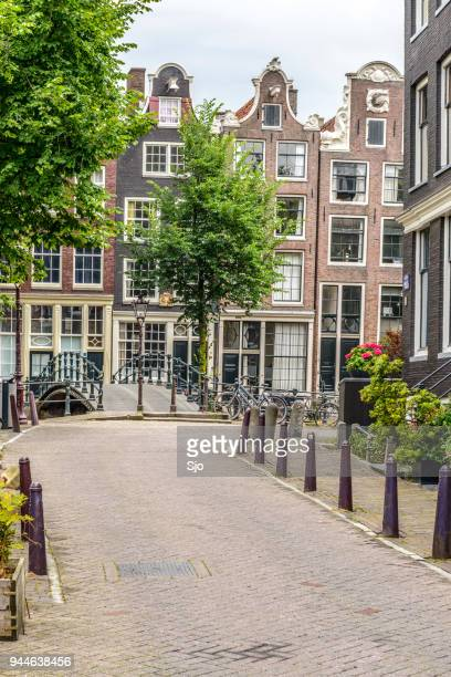Flowers at the Herengracht canal on the corner with the Brouwersgracht in Amsterdam