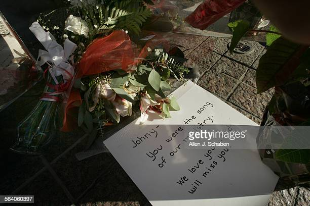 Flowers, balloons and a letter rest at the base of The Crean Tower, left by a mourner of Crystal Cathedral Orchestra conductor, Johnnie Carl who...
