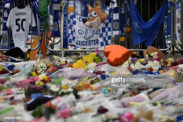 Flowers balloons scarfs and banners including a fox balloon are left in tribute outside Leicester City Football Club's King Power Stadium in...