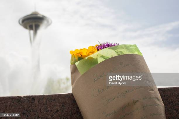 Flowers bearing a message in memory of Chris Cornell rest in front of a fountain in Seattle Center near the Space Needle on May 18 2017 in Seattle...