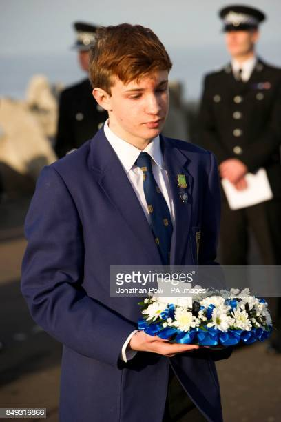 Flowers being laid at the memorial service in Gynn Square Blackpool to mark the 30th anniversary of three Blackpool police officers losing their...