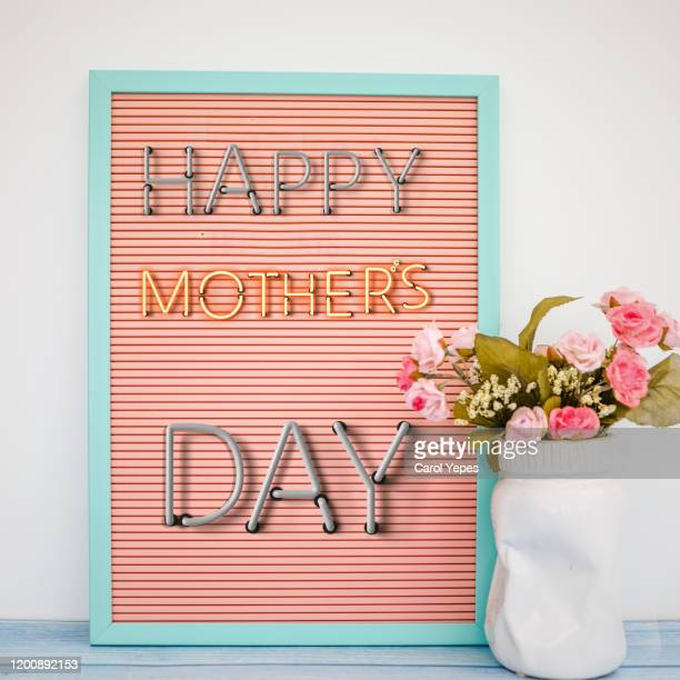flowers bouquet and mothers day text on banner - mothers day stock pictures, royalty-free photos & images