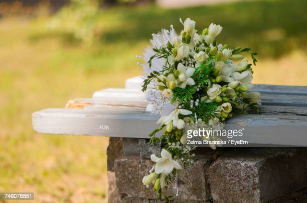Flowers Bouquet On Bench During Wedding