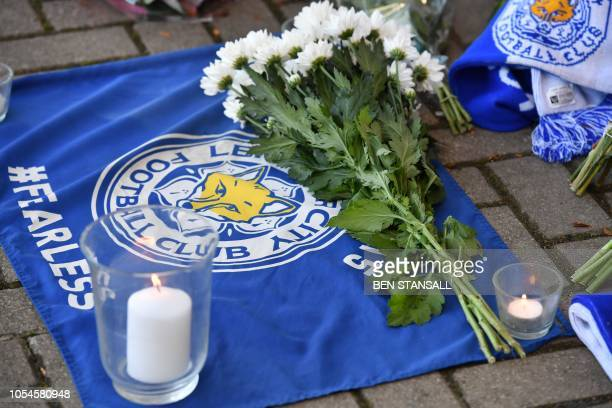 Flowers candels and flags are left as tributes outside Leicester City Football Club's King Power Stadium in Leicester eastern England on October 28...