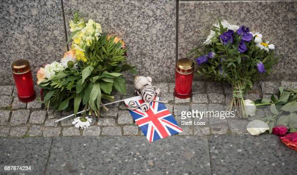Flowers candles and a flag of the United Kingdom lay in front of British Embassy on May 24 2017 in Berlin Germany An explosion occurred at Manchester...
