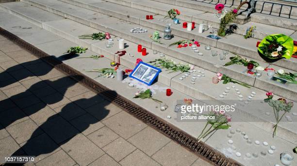 Flowers candles and a photo of trainee Niklas Feierabend of German Bundesliga soccer club Hanover 96 at the stairs of the city hall in Hemmingen near...