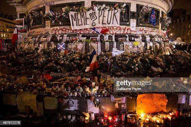"""Flowers, candles and messages left as a memorial in """"Monument à la République"""" in the 11th district of Paris, following a series of coordinated..."""