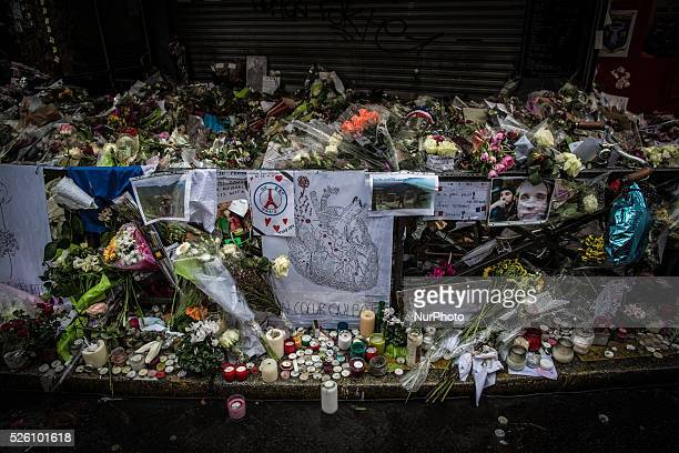 Flowers candles and messages left as a memorial in quotLa Belle Equipequot restaurant in the 11th district of Paris on November 21 2015 following a...
