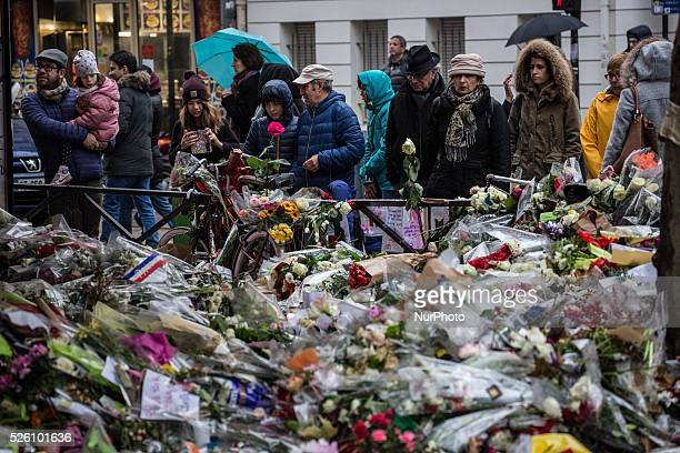 """Flowers, candles and messages left as a memorial in """"La Belle Equipe"""" restaurant in the 11th district of Paris, on November 21, 2015..."""
