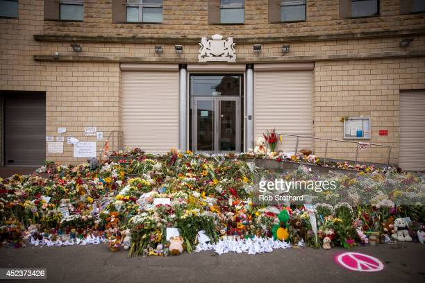Flowers candles and other tributes in front of the Netherlands Embassy in memory of the victims of Malaysia Airlines flight MH17 on July 19 2014 in...