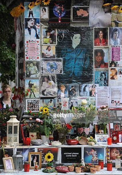 Flowers candles and personal notes for the King of Pop Michael Jackson are laid down on a monument dedicated to FrancoFlemish Renaissance composer...