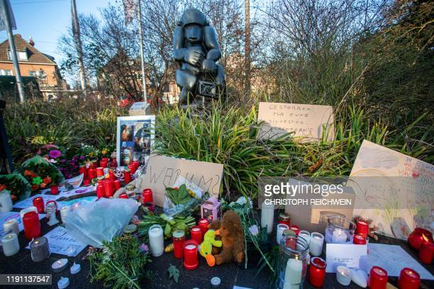 Flowers candles and placards are placed at a makeshift memorial for animals that died in a fire at the zoo's monkey house on January 1 2020 at the...