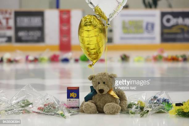 Flowers cards and sentimental gifts adorn the ice surface at Humboldt Uniplex during preparations for a prayer vigil for the Humboldt Broncos ice...
