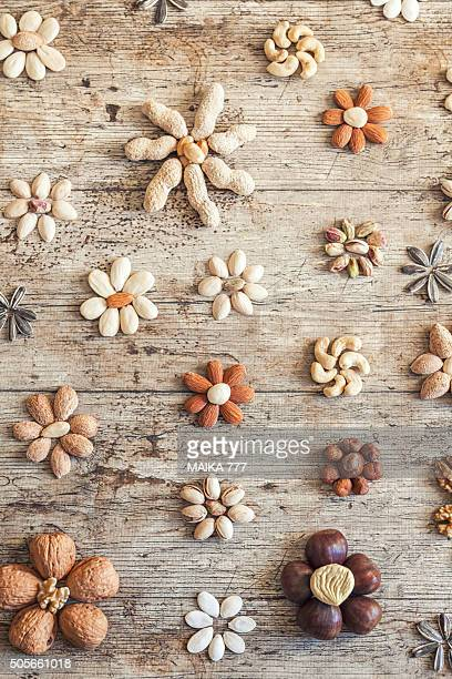 Flowers composed by variety of dry fruits.