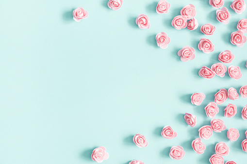 Flowers composition. Pink rose flowers on pastel blue background. Valentines day, mothers day, womens day, spring concept. Flat lay, top view, copy space 1128621856