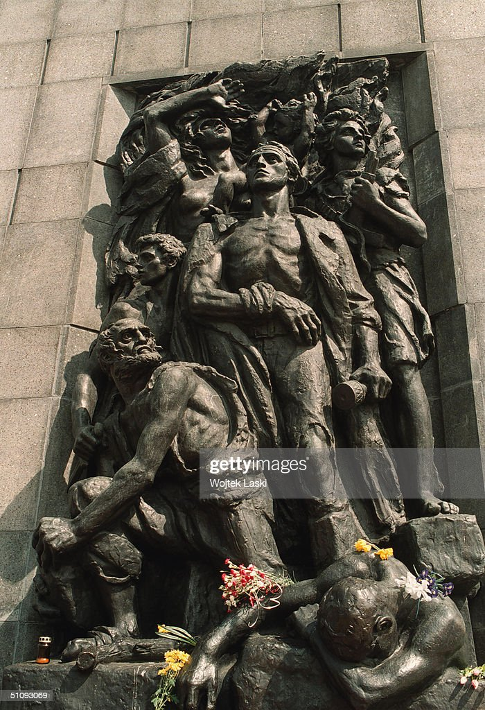 Flowers Cover Part Of The Warsaw Ghetto Heroes Monument April 19, 2001 In Warsaw, Poland. The Monument, Created By L.M. Suzin, Commmemorates Tens Of Thousands Of Warsaw Ghetto Jews Who On April 19,1943 Began An Intense But Unsuccessful Uprising Against The Occupying Nazis.