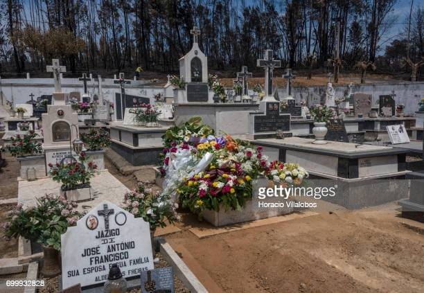 Flowers cover the grave of one of the victims of the forest fire at the small village cemetery on June 22 2017 in Vila Facaia Portugal This small...