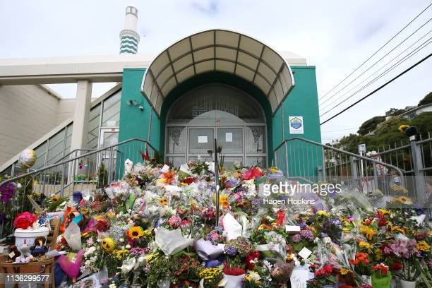 Flowers cover the steps of the Kilbirnie Mosque on March 17 2019 in Wellington New Zealand 50 people are confirmed dead and 36 are injured still in...