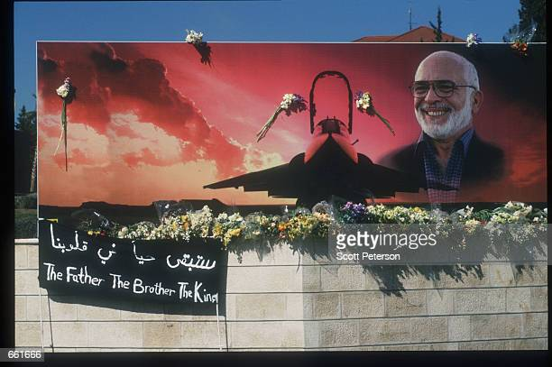 Flowers decorate a mural of deceased King Hussein February 9 1999 in Amman Jordan Hussein was a popular figure who strove for peace in the Middle...