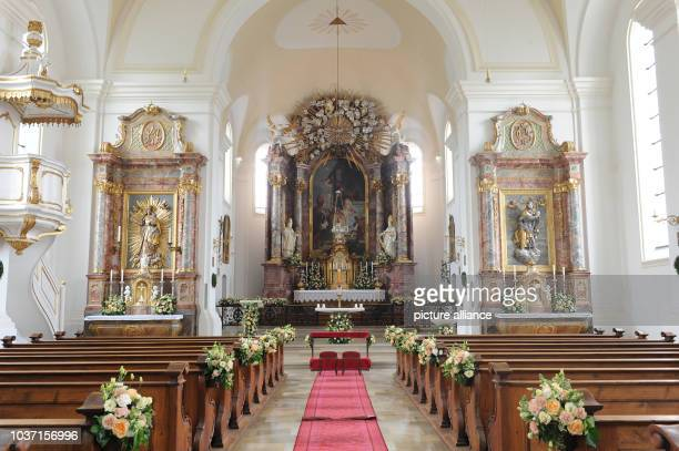 Flowers decorate the central nave and the altar in the church of Saint Joseph prior to the wedding of Maria Theresia von Thurn and Taxis and Hugo...