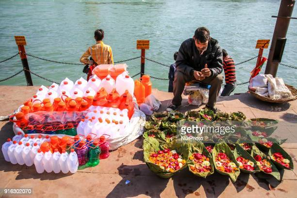 Flowers earthen lamps sale for worship in Haridwar Uttrakhand India on 8th Feb 2018 Haridwar is a major attraction for the pilgrims around the world...