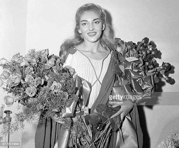 Flowers fill her arms as joy fills her heartthat is what this picture of soprano Maria MeneghiniCallas tells us It was made after her impressive...