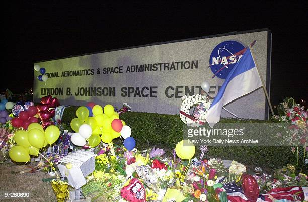Flowers flags and balloons form a makeshift memorial at the entrance to the Johnson Space Center in Houston to the seven astronauts who died...